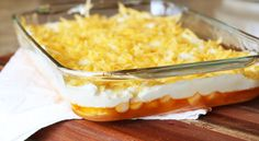 Edna's Orange Jell-O - from Lilyshop Blog by Jessie Jane;  This sounds great for a potluck dinner side dish.  The Jell-O has sliced bananas and crushed pineapple, and the custard topping tastes like pineapple ice cream according to the blogger.