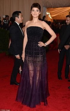 Love it <3  Gothic: Marion Cotillard opted for a grungy look with her black bustier and purple chiffon dress