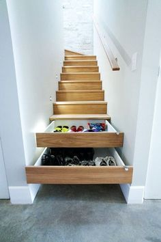 If you're redesigning your home, consider adding cabinets into your staircase for unexpected but oh-so-useful storage.