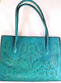 Stunning embossed turquoise leather.