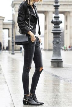 Black moto jacket + black ripped skinny jeans + ankle boots + a black purse. We are obsessed.