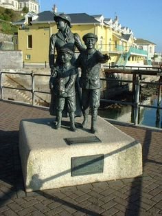 Annie Moore Statue, Cobh, Co. Cork - Annie Moore (January 1, 1877 - 1923) was the first immigrant to the United States to pass through the Ellis Island facility in New York Harbor. She departed from Cobh, County Cork, accompanied by her brothers Phillip and Anthony, aboard the steamship Nevada on January 1, 1892, her fifteenth birthday.