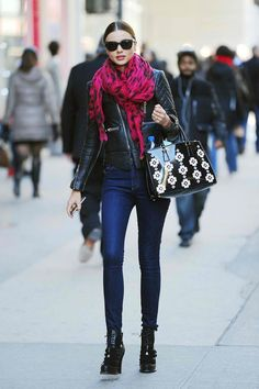 Tight classic jeans, printed scarf, and leather jacket make Miranda's look super cute and chic for markets with cooler temperatures
