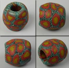 """Ancient """"Fustat"""" glass mosaic bead from Old Cairo.  Bead measures about 20 mm in diameter."""