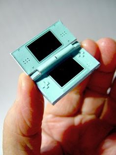 Mini printable DS. So cute! Looks hard to put together though..... There is also printable box designed to look like the package DS come in here: http://fxconsole.blogspot.com/2008/08/miniature-paper-ds-box.html
