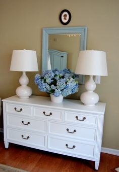 LOVE this dresser, its hardware, the light blue mirror, and these lamps. How to recreate this at home...?