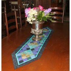 Elegant Diamond Life Table Runner is for intermediate quilters