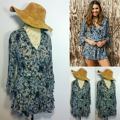 """NWT L Free People Ruffle Romper Bring your inner Boho-chic out with this Ruffle Romper (L) $128 Original Retail Value Overall length 32"""" Inches armpit to armpit 23"""" inches w/garment laying flat across... Waist Midsection will fit a 30""""-34"""" inch waist due to the elastic band Sleeves are 20"""" inches long Free People Dresses Mini"""