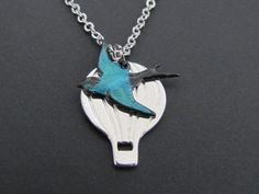 SALE 10% OFF - Hot-air Balloon and bird necklace in white gold. $18.50, via Etsy.