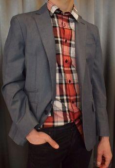 Horst plaid shirt $110 and grey notch blazer $495 from Gotstyle Menswear.