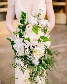 Gorgeous cascading bouquet designed by Fleur Inc.