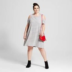 • Model wears size 16/X and is 5'10''<br>• Easy-care, lightweight fabric<br>• Cold shoulder cut outs add a trendy touch<br>• Relaxed fit with a flattering A-line cut<br><br>Sassy and stylish, the Women's Plus Size Knit Cold Shoulder Dress - Ava & Viv™ will be your new day-off favorite. With its relaxed silhouette and trendy cold shoulder cut-outs, this women's dress has an...