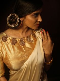 A golden blouse design is the ultimate option to wear with most sarees in your closet! Here are 20 golden blouse design ideas to show your tailor before stitching one. Golden Blouse Designs, Simple Blouse Designs, Bridal Blouse Designs, Blouse Neck Designs, Blouse Patterns, Jacqueline Fernandez, Saris, Kerala Saree Blouse Designs, Sari Bluse