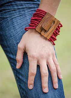 Trades of Hope - Journey Bracelet Product # [JBS327] Add bohemian flair to your look with this fabulous item: sixteen strands of red beads clasp with a large 2×2-inch wood-look hook, creating a 3-inch diameter wrap. $ 28.00