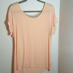 BCBG Peach Soft Tee This shirt is in excellent condition! No holes, stains, or signs of shrinking. Shirt is ever so slightly see through but would look super cute with a bralette. 95% rayon 5% spandex. Meant to have an oversized look so it works good for size medium or large.   *Bundle 3 items or more for 10% off  *No trades   *Feel free to make reasonable offers ? BCBGeneration Tops Tees - Short Sleeve