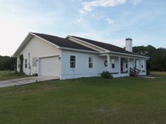 New Listing!! Need Privacy?? 38 Acres of land plus a 12 stall pole barn and a 3 Bedroom 2.5 Bath home with a custom made fireplace and full length of house rear porch. Home is of steel frame construction. Land was home to 25 horses. Great place to raise cattle. 2402 sq ft. htd. 3734 total sq ft. Built 2005. Polk City Location. Professional Photography coming soon. 650 ft of road frontage and home sits back at least 10 acres from road. Asking price $449,000. Listed 2 December 2013