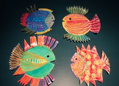 "Make a paper plate fish inspired from the Barefoot Book ""My Mama Earth"""