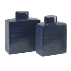 Wilfred Ceramic Canisters - Set of 2 - Add a moody blue set of two rectangular ceramic canisters to any tabletop for a sleek accent. Adds a refreshing coolness and coordinates with a variety of decor. IMAX exclusive!