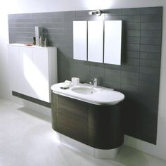 Modern Bathroom With Black Wall Tiles And Large Mirror also Ceramics Tiles and Undermount Bath Sink also Storage Cabinet and Downlights