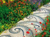 Use pebbles of various colors and shapes to build creative patterns into pathway designs.