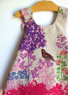 Wish Border Pink Birds Reversible Modern Pinafore Dress by Noah and Lilah - handmade pinnie - butterfly applique. $42.00, via Etsy.