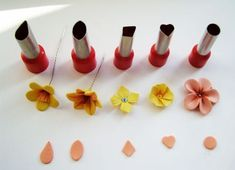 How to make clay flower petals with cutters! No detail, this picture sez it all. #polymer #clay #tutorial by angelique