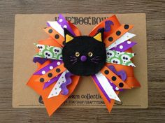 Hair Boo! (Oops, I mean... Yes, Hair Bow!)  I am very happy to introduce you one of my latest creations, Hair Boo! in Black Cat from Crafty Tomatos Halloween Collection.  The bow measures about 4.5x5 and the black cat on top measures about 2x2. It is on a regular-sized alligator hair clip.  This very unique, outstanding Hair Bow is going to brighten up your and your little ones Halloween season for sure!  Thank you for your interest and please feel free to contact me if you have any…
