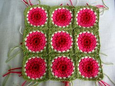 So pretty!  It's just a sunburst granny with red gradating to pink with a green border.  This will be so pretty.  The only thing that would be annoying about this blanket is having to make every square exactly the same.