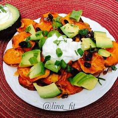 Loaded Sweet Potato Nachos!!!! Absolutely amazing ... Even the kids gave it a and they are my biggest critics Ingredients: 3 large sweet potatoes washed and sliced into 1/4 inch rounds 1 tablespoon olive oil salt and pepper 1 1/2 cups of shredded cheddar cheese 1 cup black beans drained and rinsed 1/4 cup chopped green onions 1/4 cup chopped cilantro 1 large avocado diced Greek yogurt or Sour cream Directions : Preheat oven 400 degrees Place sweet potatoes on large baking sheet/sheets . Toss…