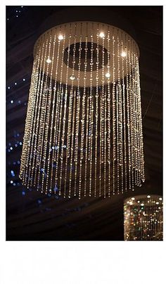 Pot lights mounted into the base of the wooden frame shine on the gem strings for a glittery display.