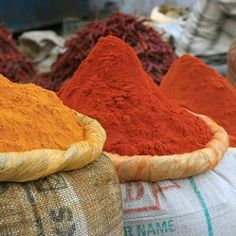 If you cook with Indian dishes, you are likely to come into counter with the ingredient turmeric. It is a common ingredient used in curry dishes. However, if you spill it, the deep-orange spice will leave a reddish stain on your clothes or linens.  Laundering them as you normally would will leave a permanent pink stain and thereby ruin the fabric.