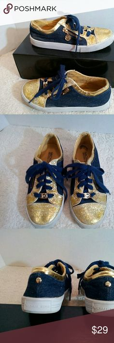 Girls Michael Kors sneakers gold sparkles and dark blue denim make these adorable sneakers; MK charm on the laces in front; zipper on the side with another charm but one of those is missing; expected wear - some of the gold sparkles is uneven/slight scuffing but overall good condition; Michael Michael Kors size 3  (T-3) MICHAEL Michael Kors Shoes Sneakers