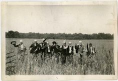 Survivors of Pickett's Charge walk the field their comrades fell upon. Gettysburg 50th anniversary, July 3, 1913.