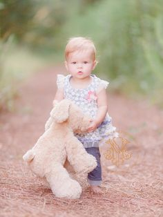 Athens, GA outdoor baby photography of a one year old with her stuffed bunny in…