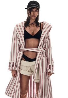 Stripping down, Irina Shatk models Balenciaga wrap coat and baseball cap for Vogue Magazine Brazil January 2017 issue