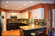 My orange kitchen! Black and white painted two-tone cabinets. Cheerful, playful and fun!