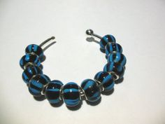 20 Blue & Black Striped Euro Beads. Starting at $5 on Tophatter.com!  http://tophatter.com/auctions/28088?type=partner
