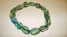 1pc Green Fluorite Extra Quality 10mm Tumbled Nuggets 100% Natural Tumbled Stone Gemstone Crystal Healing Stretch Bracelets Sublime Gifts http://www.amazon.com/dp/B00UUCRH4A/ref=cm_sw_r_pi_dp_Yyuiwb0CVPFHG