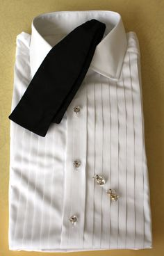 This is what im looking for in a a bow tie...wide (about 3 in) and Faille (bat-winged)...nothing else will do...clean formal shirt, cuff, button and bowtie set