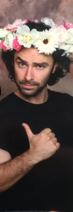 He's wearing flowers in his hair so that means its summer ! any excuse to pin Aidan !!!