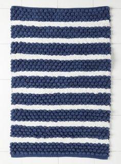 Love the blue and white bath rug idea