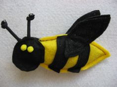 """MR BUMBLE Catnip Toy  MR BUMBLE Catnip Toy Mr Bumble is buzzing your way !! He is made of felt and his sparkling wings make a crinkling noise . He is filled with 100 % Organic Catnip grown in Montana .  The BEST in all the WORLD !!!!  6 """" in length www.catchinglizards.com"""