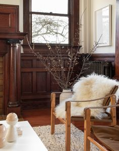 One of the refurbished radiators stands behind a pair of vintage safari chairs. All of the Icelandic Sheepskins are from Hawkins New York.