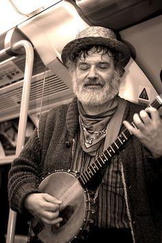 bearded banjo man in the london underground