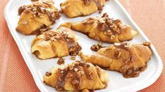 Bake Pillsbury® dinner rolls to make these sticky pear crescents topped with pecans – a wonderful baked dessert.