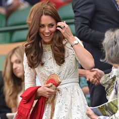 Kate Middleton in a Zimmermann white lace dress