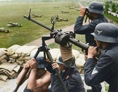 A Luftwaffe anti-aircraft team operating an mm machine gun at an airfield perimeter in the summer of Note the attached canvas spent shell catcher and Messerschmitt Bf in the background. Luftwaffe, German Soldiers Ww2, German Army, Mg34, Germany Ww2, German Uniforms, Ww2 Photos, Military Pictures, War Photography