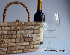 can be made cheaply by buying a or using a wooden cigar box & handles at Micheals. the trick is cutting the corks