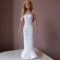 Mini or Long Crochet Barbie Dress...  the back is laced up...  very pretty  **free pattern**  FYI:  I use smaller size sock tops to make Barbie dresses.  Cut the top above the heel.  Put a hole on either side at the top for arm holes.  Tie waist with a ribbon, you can snip the hem for a fringe look.  They are quiet cute, longer socks, longer dresses.