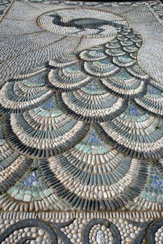 Peacock mosaic looks so fabulous.